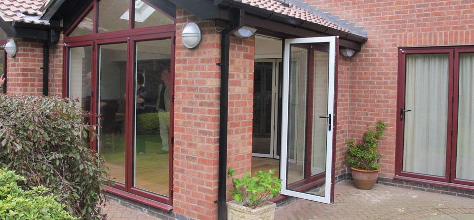 red-on-white-aluminium-multifold-doors
